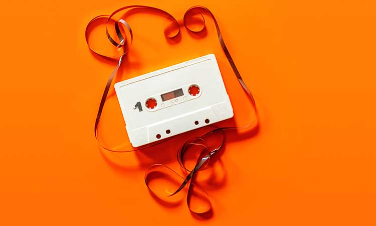 a motto night, old casette on orange background