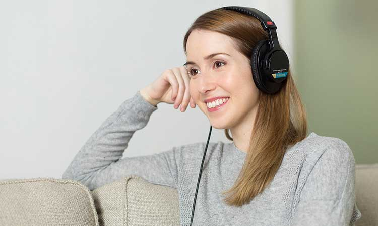 woman listening to motivational Podcast