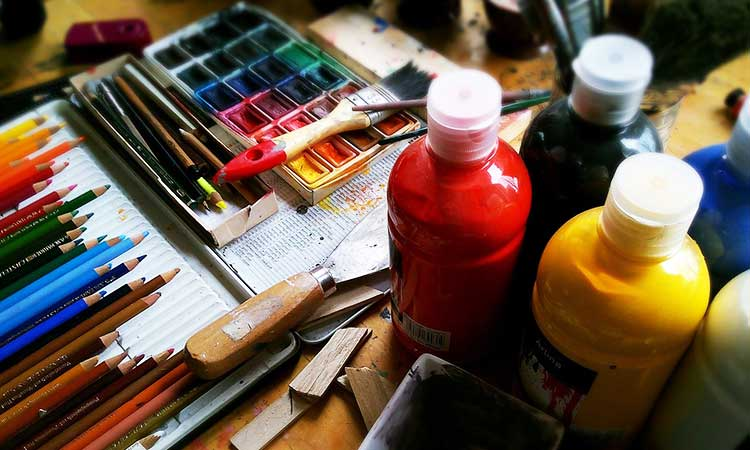 painting, paints, paper and pens for the hobby at home