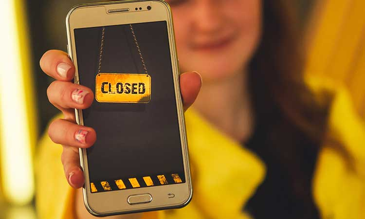 phone screen, closed sign in yellow