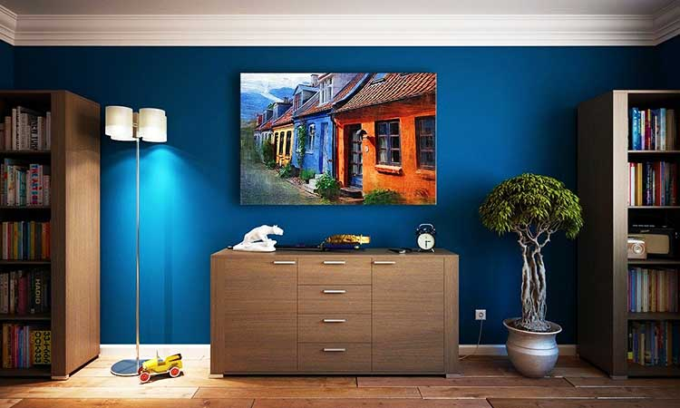 decoration, flat, blue wall, painting over furniture, little tree